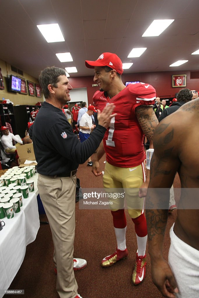 Head Coach Jim Harbaugh of the San Francisco 49ers talks with Colin Kaepernick #7 in the locker room following the game against the Arizona Cardinals at Candlestick Park on December 30, 2012 in San Francisco, California. The 49ers defeated the Cardinals 27-13.