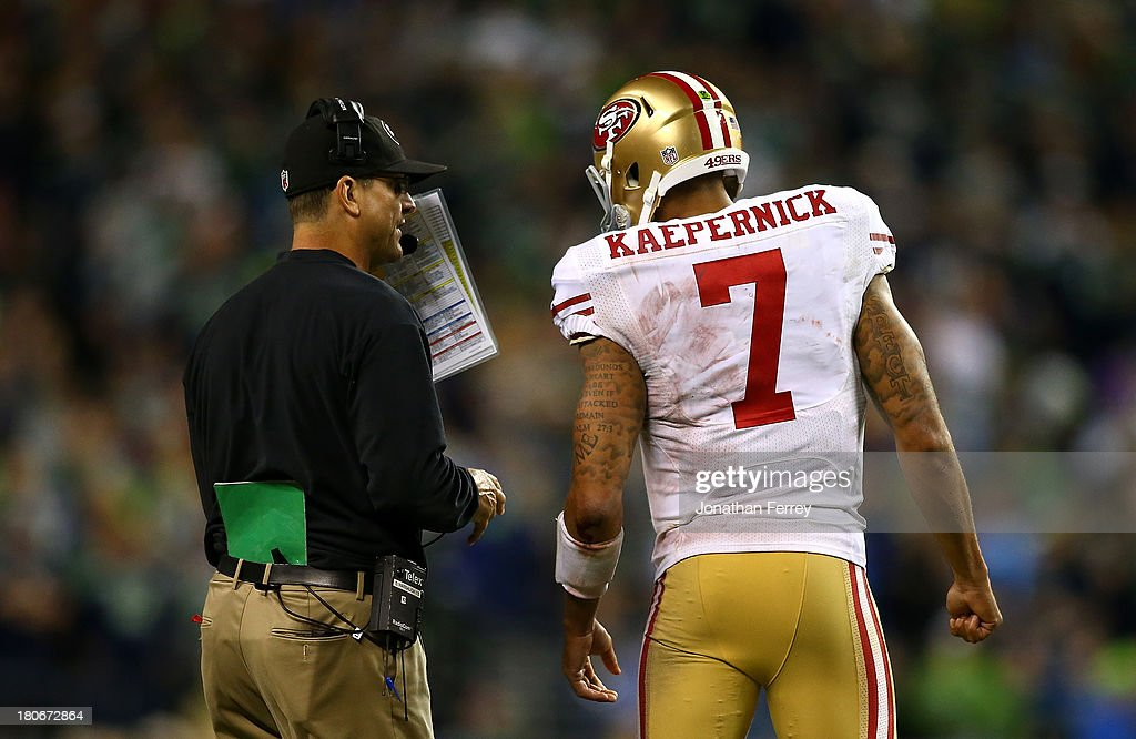 Head Coach <a gi-track='captionPersonalityLinkClicked' href=/galleries/search?phrase=Jim+Harbaugh&family=editorial&specificpeople=779595 ng-click='$event.stopPropagation()'>Jim Harbaugh</a> of the San Francisco 49ers talks with quarterback <a gi-track='captionPersonalityLinkClicked' href=/galleries/search?phrase=Colin+Kaepernick&family=editorial&specificpeople=5525694 ng-click='$event.stopPropagation()'>Colin Kaepernick</a> #7 against the Seattle Seahawks on September 15, 2013 at CenturyLink Field in Seattle, Washington.