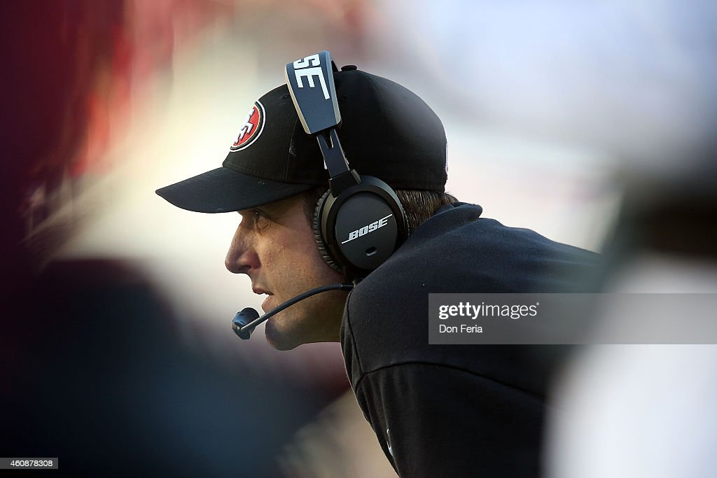 head coach <a gi-track='captionPersonalityLinkClicked' href=/galleries/search?phrase=Jim+Harbaugh&family=editorial&specificpeople=779595 ng-click='$event.stopPropagation()'>Jim Harbaugh</a> of the San Francisco 49ers watches the action on the field in the third quarter against the Arizona Cardinals at Levi's Stadium on December 28, 2014 in Santa Clara, California.