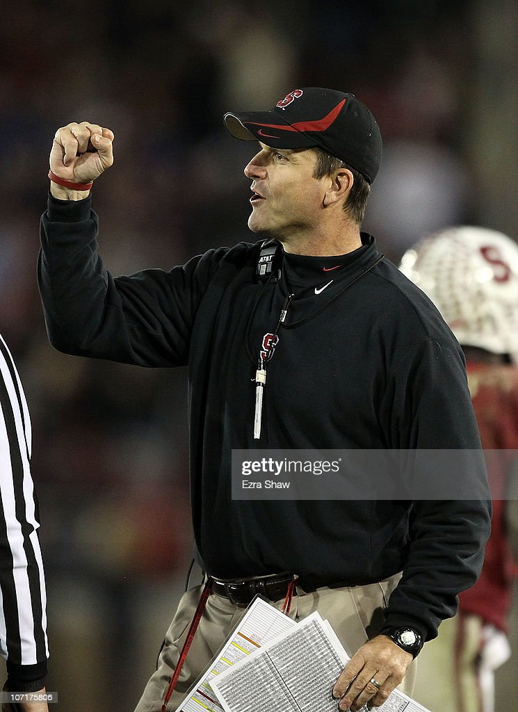 Head coach <a gi-track='captionPersonalityLinkClicked' href=/galleries/search?phrase=Jim+Harbaugh&family=editorial&specificpeople=779595 ng-click='$event.stopPropagation()'>Jim Harbaugh</a> of the Stanford Cardinal reacts after Delano Howell #26 of the Stanford Cardinal made an interception on a pass intended for Joe Halahuni #87 of the Oregon State Beavers at Stanford Stadium on November 27, 2010 in Palo Alto, California.