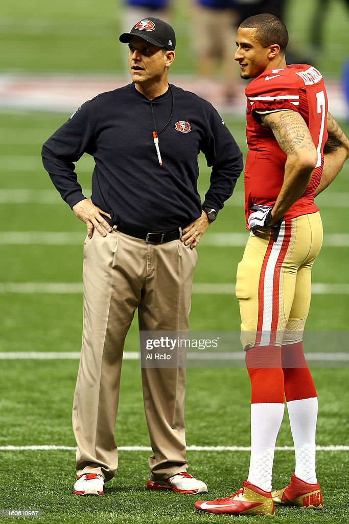 Head coach Jim Harbaugh speaks to Colin Kaepernick #7 of the San Francisco 49ers during warm ups prior to Super Bowl XLVII at the Mercedes-Benz Superdome on February 3, 2013 in New Orleans, Louisiana.