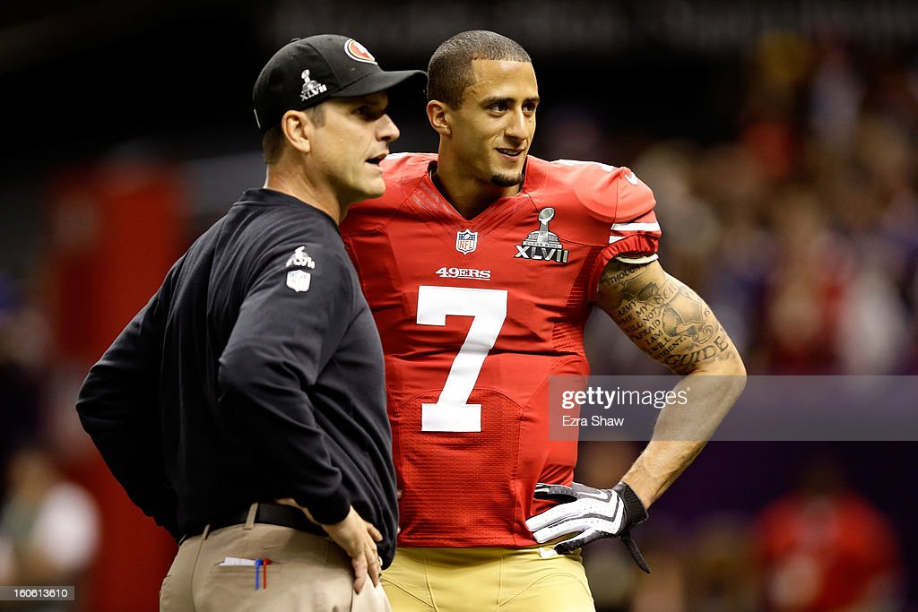 Head coach Jim Harbaugh speaks to Colin Kaepernick #7 of the San Francisco 49ers during warm ups prior to Super Bowl XLVII against the Baltimore Ravens at the Mercedes-Benz Superdome on February 3, 2013 in New Orleans, Louisiana.