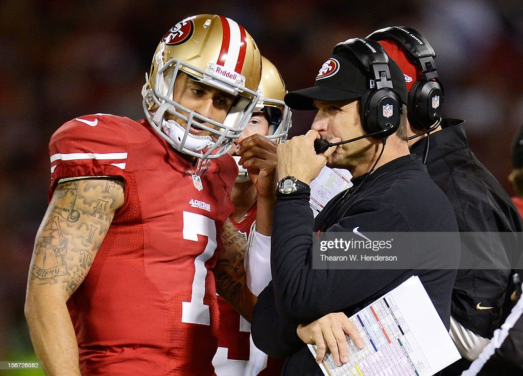 Head coach Jim Harbaugh talks to Colin Kaepernick #7 of the San Francisco 49ers in the second quarter against the Chicago Bears at Candlestick Park on November 19, 2012 in San Francisco, California.