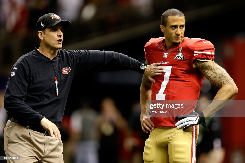 Head coach Jim Harbaugh taps Colin Kaepernick #7 of the San Francisco 49ers on the chest during warm ups prior to Super Bowl XLVII against the Baltimore Ravens at the Mercedes-Benz Superdome on February 3, 2013 in New Orleans, Louisiana.