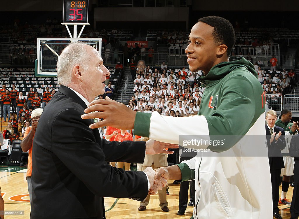 Head coach Jim Larranaga greets Kenny Kadji #35 of the Miami Hurricanes as he is introduced on senior day prior to the game against the Clemson Tigers on March 9, 2013 at the BankUnited Center in Coral Gables, Florida. The Hurricanes defeated the Tigers 62-49 and won the Atlantic Coast Conference Championship.