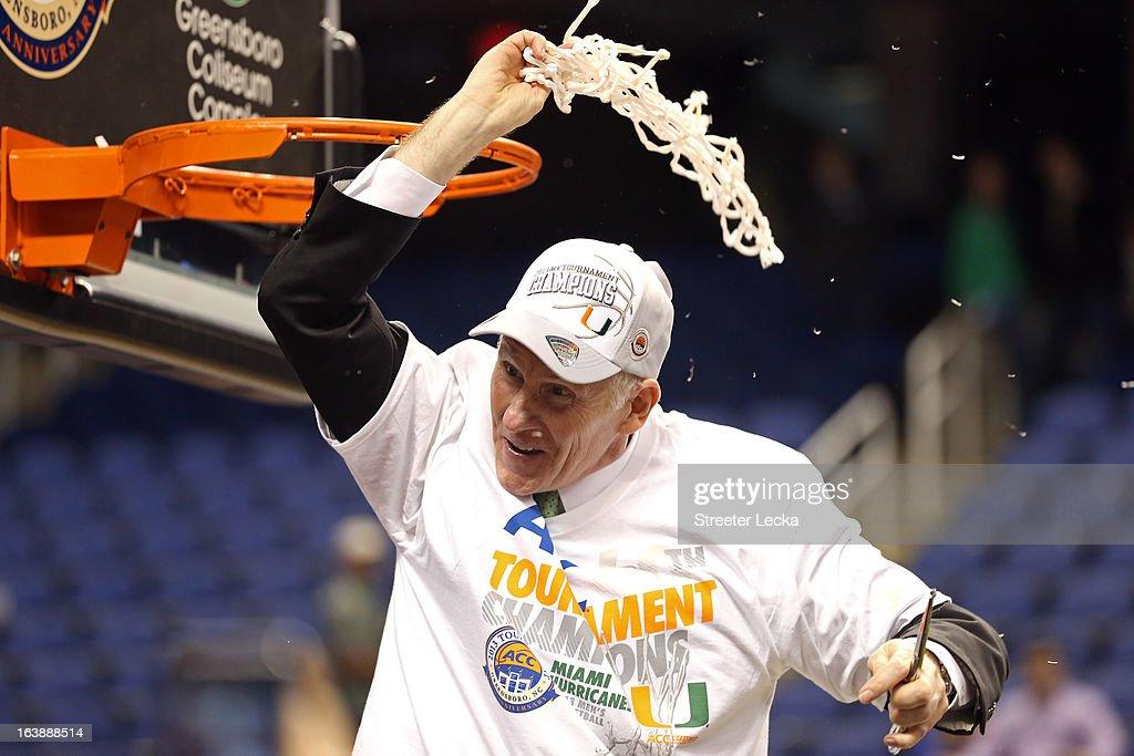 Head coach Jim Larranaga of the Miami Hurricanes celebrates after he cuts down the net following Miami's 8777 win against the North Carolina Tar...