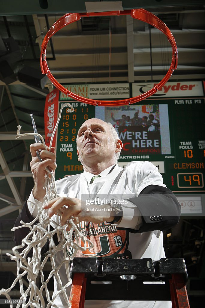 Head coach <a gi-track='captionPersonalityLinkClicked' href=/galleries/search?phrase=Jim+Larranaga&family=editorial&specificpeople=694107 ng-click='$event.stopPropagation()'>Jim Larranaga</a> of the Miami Hurricanes cuts down the basketball net after the game against the Clemson Tigers on March 9, 2013 at the BankUnited Center in Coral Gables, Florida. The Hurricanes defeated the Tigers 62-49 and won the Atlantic Coast Conference Championship.