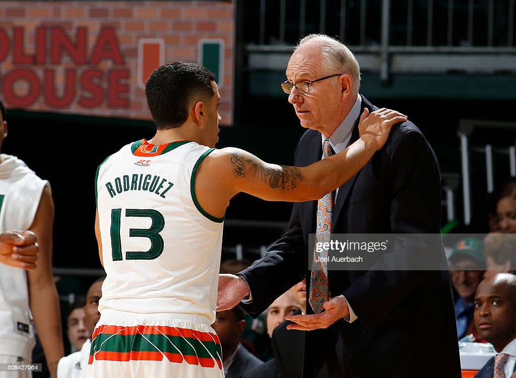 Head coach Jim Larranaga talks to Angel Rodriguez of the Miami Hurricanes after a technical foul was call during second half action against the Wake...