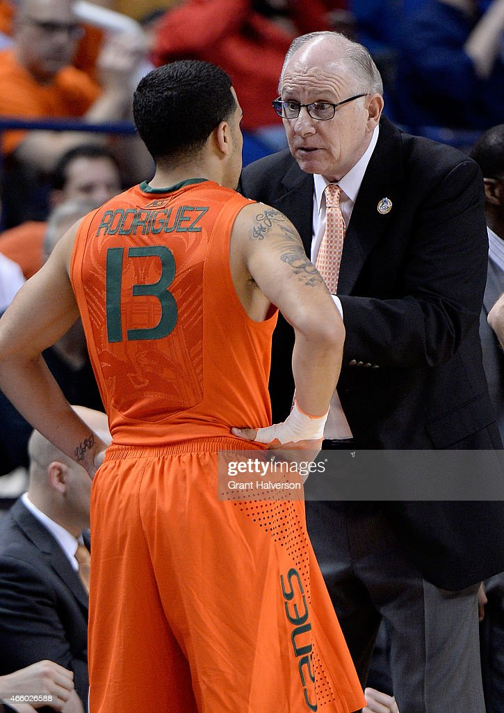 Head coach Jim Larranaga talks with Angel Rodriguez of the Miami Hurricanes during a game against the Notre Dame Fighting Irish the quarterfinals of...