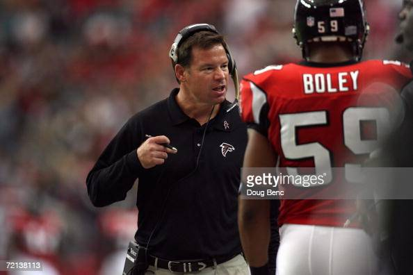 Head coach Jim Mora of the Atlanta Falcons reacts as he walks the sidelines next to linebacker Michael Boley during a game against the Arizona...