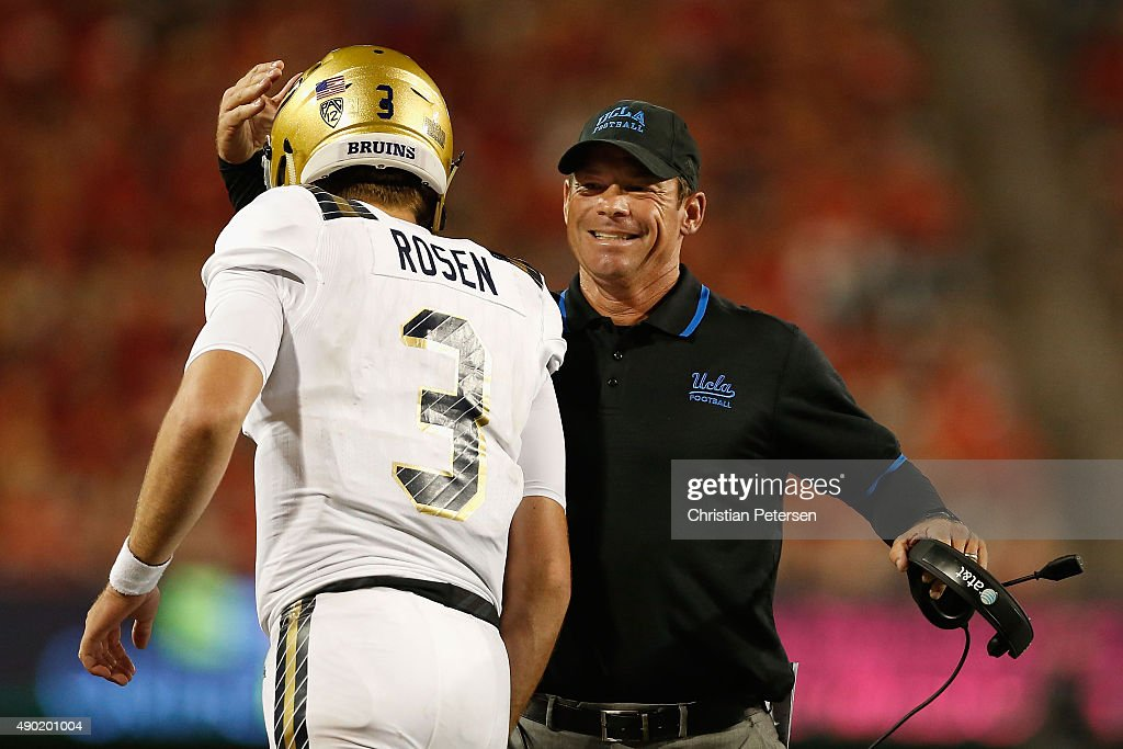 Head coach <a gi-track='captionPersonalityLinkClicked' href=/galleries/search?phrase=Jim+Mora&family=editorial&specificpeople=210729 ng-click='$event.stopPropagation()'>Jim Mora</a> of the UCLA Bruins congratulates quarterback <a gi-track='captionPersonalityLinkClicked' href=/galleries/search?phrase=Josh+Rosen+-+American+Football+Player&family=editorial&specificpeople=15015415 ng-click='$event.stopPropagation()'>Josh Rosen</a> #3 after Rosen scored on a eighth yard rushing touchdown against the Arizona Wildcats during the third quarter of the college football game at Arizona Stadium on September 26, 2015 in Tucson, Arizona. The Bruins defeated the Wildcats 56-23.
