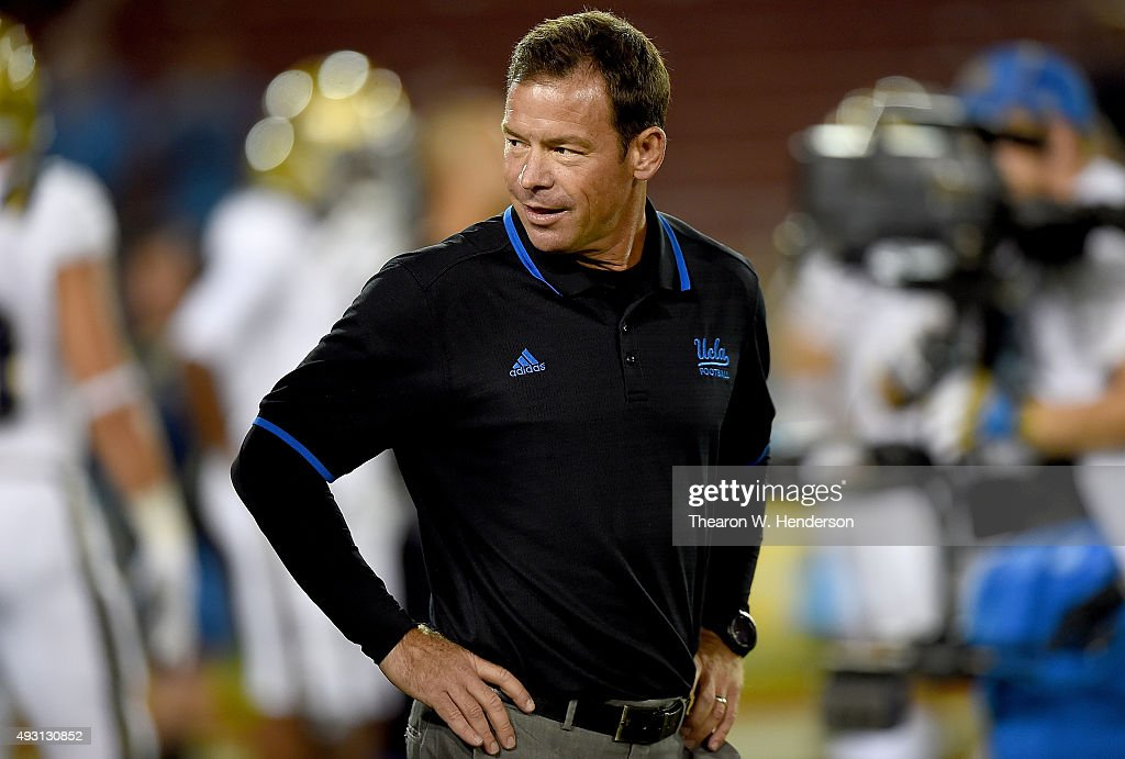 Head coach <a gi-track='captionPersonalityLinkClicked' href=/galleries/search?phrase=Jim+Mora&family=editorial&specificpeople=210729 ng-click='$event.stopPropagation()'>Jim Mora</a> of the UCLA Bruins looks on while his team warms up in pregame warm ups prior to playing the Stanford Cardinal at Stanford Stadium on October 15, 2015 in Stanford, California.