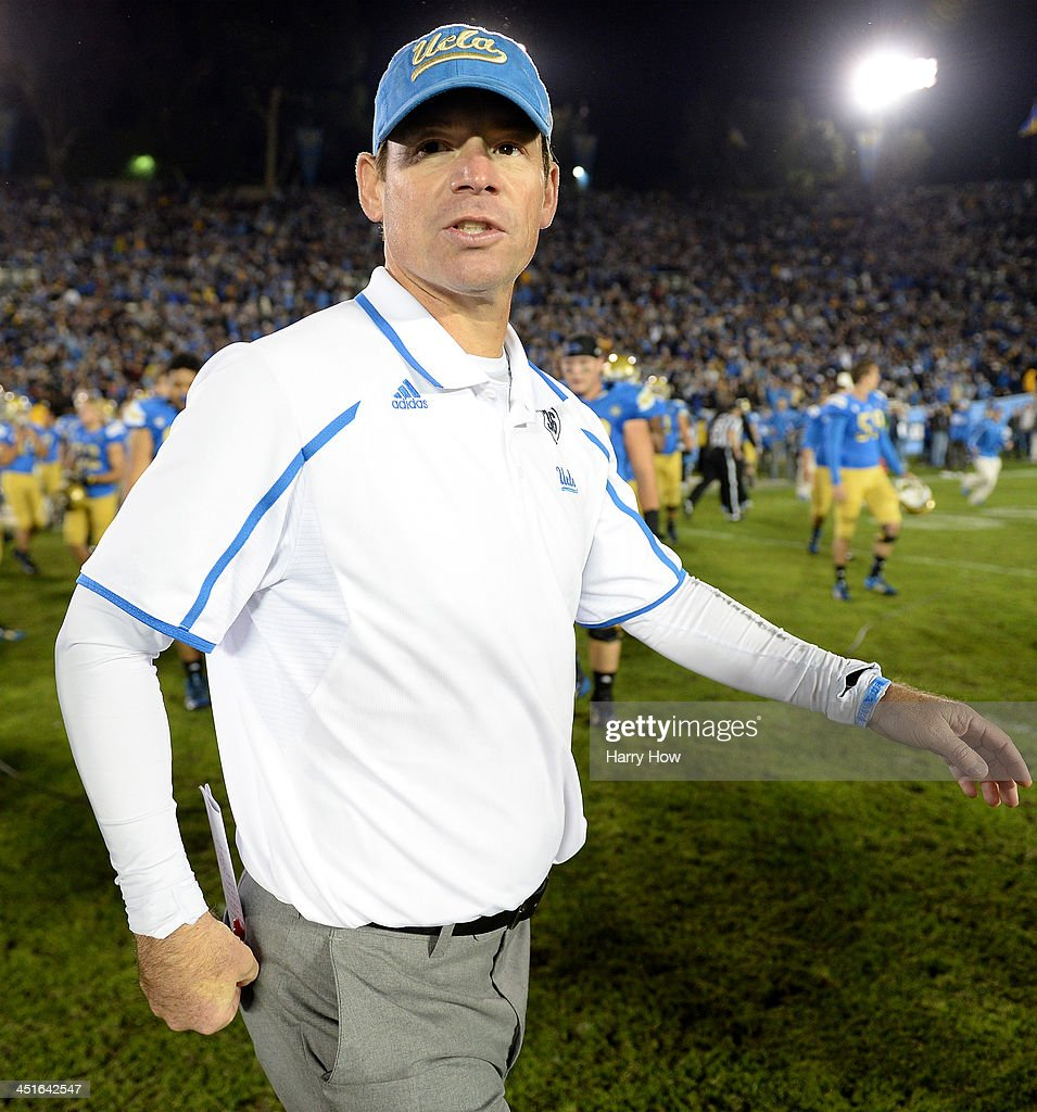 Head coach <a gi-track='captionPersonalityLinkClicked' href=/galleries/search?phrase=Jim+Mora&family=editorial&specificpeople=210729 ng-click='$event.stopPropagation()'>Jim Mora</a> of the UCLA Bruins reacts after a 38-33 loss to the Arizona State Sun Devils at Rose Bowl on November 23, 2013 in Pasadena, California.