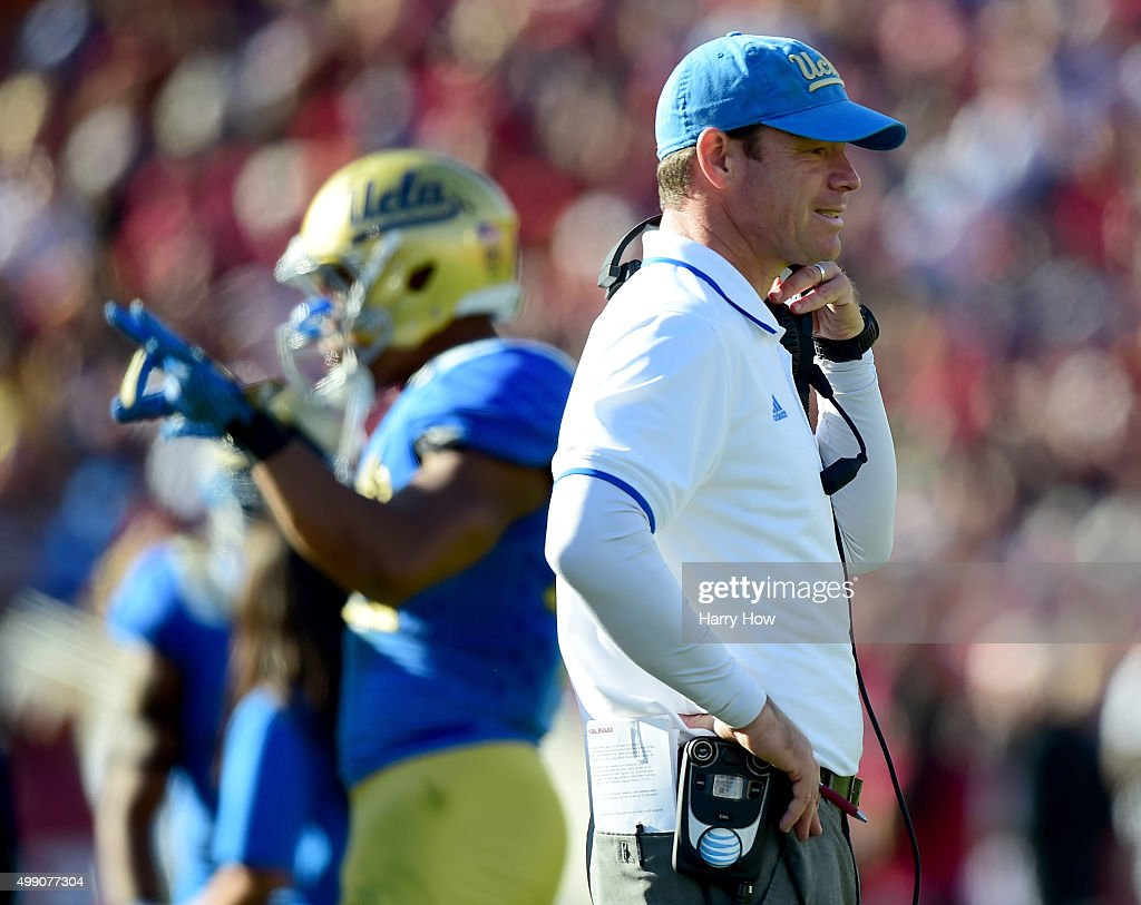 head coach <a gi-track='captionPersonalityLinkClicked' href=/galleries/search?phrase=Jim+Mora&family=editorial&specificpeople=210729 ng-click='$event.stopPropagation()'>Jim Mora</a> of the UCLA Bruins reacts after a touchdown to take a 14-10 lead over the USC Trojans during the second quarter at Los Angeles Memorial Coliseum on November 28, 2015 in Los Angeles, California.