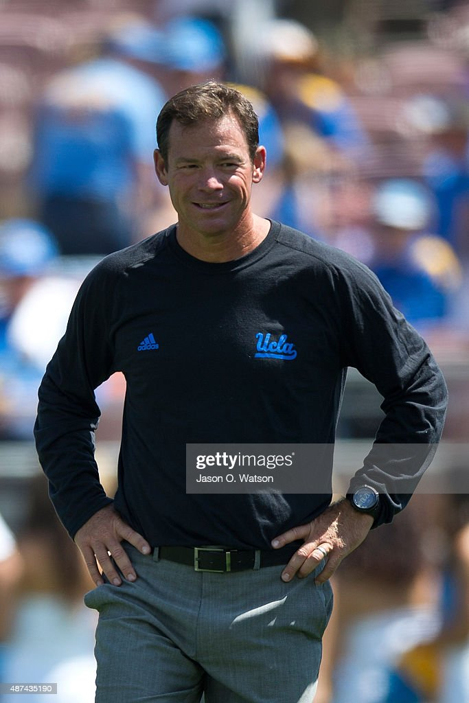 Head coach <a gi-track='captionPersonalityLinkClicked' href=/galleries/search?phrase=Jim+Mora&family=editorial&specificpeople=210729 ng-click='$event.stopPropagation()'>Jim Mora</a> of the UCLA Bruins stands on the field before the game against the Virginia Cavaliers at the Rose Bowl on September 5, 2015 in Pasadena, California. The UCLA Bruins defeated the Virginia Cavaliers 34-16.