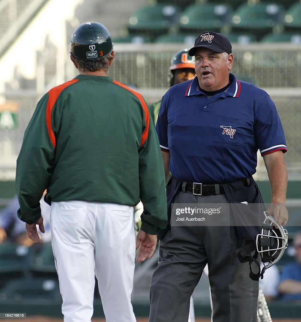 Head coach Jim Morris #3 of the Miami Hurricanes argues that Chantz Mack #2 was hit by the pitched ball with home plate umpire David Meyer in second inning action against the Columbia Lions on March 19, 2013 at Alex Rodriguez Park at Mark Light Field in Coral Gables, Florida. Miami defeated Columbia 9-6.