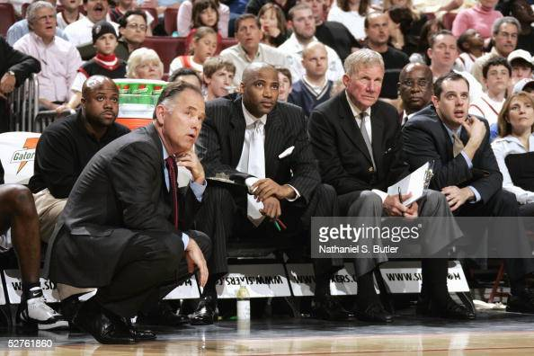 Head coach Jim O'Brien and assistant coaches Lester Conner Dick Harter and Frank Vogel of the Philadelphia 76ers watch the game against the Cleveland...