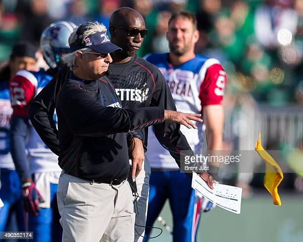 Head coach Jim Popp of the Montreal Alouettes throws the challenge flag in the game between the Montreal Alouettes and Saskatchewan Roughriders in...