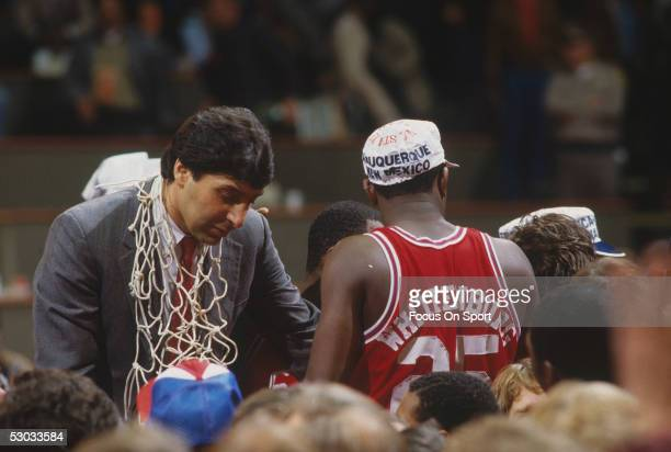 Head coach Jim Valvano of the North Carolina State Wolfpack celebrates with his team while wearing the winning net around his neck