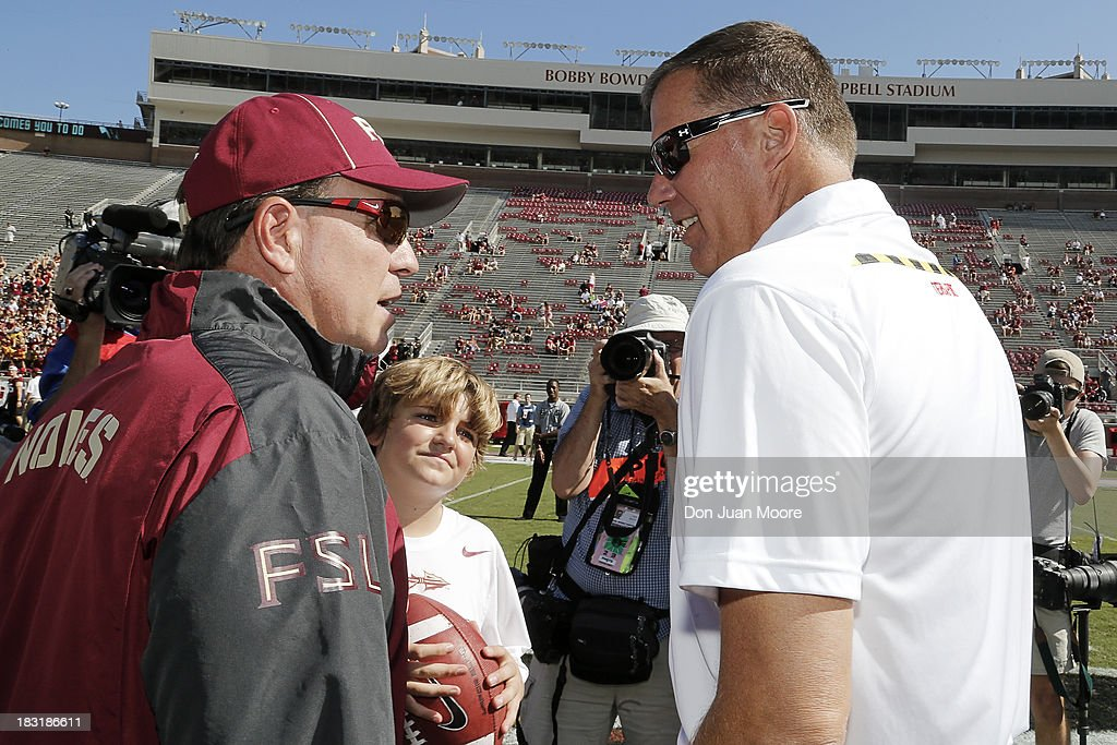 Head coach <a gi-track='captionPersonalityLinkClicked' href=/galleries/search?phrase=Jimbo+Fisher&family=editorial&specificpeople=4505734 ng-click='$event.stopPropagation()'>Jimbo Fisher</a> of the Florida State Seminoles and son Trey talk with head coach <a gi-track='captionPersonalityLinkClicked' href=/galleries/search?phrase=Randy+Edsall&family=editorial&specificpeople=2160091 ng-click='$event.stopPropagation()'>Randy Edsall</a> of the Maryland Terrapins before the game at Doak Campbell Stadium on Bobby Bowden Field on October 5, 2013 in Tallahassee, Florida. The eightth-ranked Florida State Seminoles defeated the 25th-ranked Maryland Terrapins 63-0.