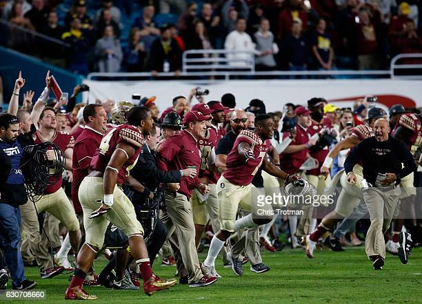 Head coach Jimbo Fisher of the Florida State Seminoles celebrates their 33 to 32 win over the Michigan Wolverines during the Capitol One Orange Bowl...