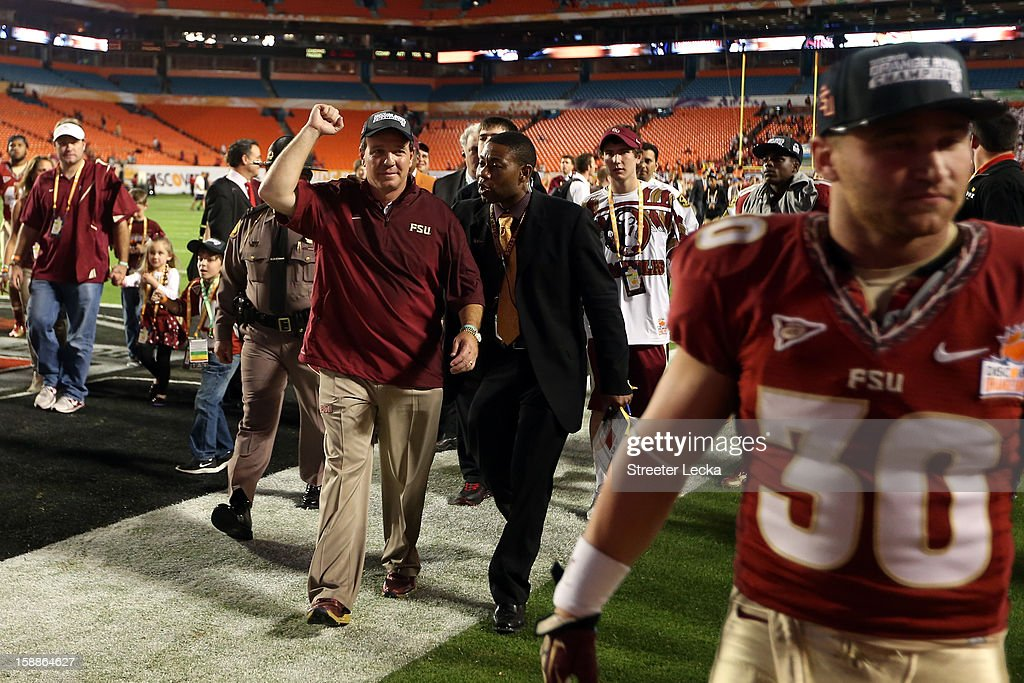Head coach Jimbo Fisher of the Florida State Seminoles celebrates as he walks off the field after they won 31-10 against the Northern Illinois Huskies during the Discover Orange Bowl at Sun Life Stadium on January 1, 2013 in Miami Gardens, Florida.