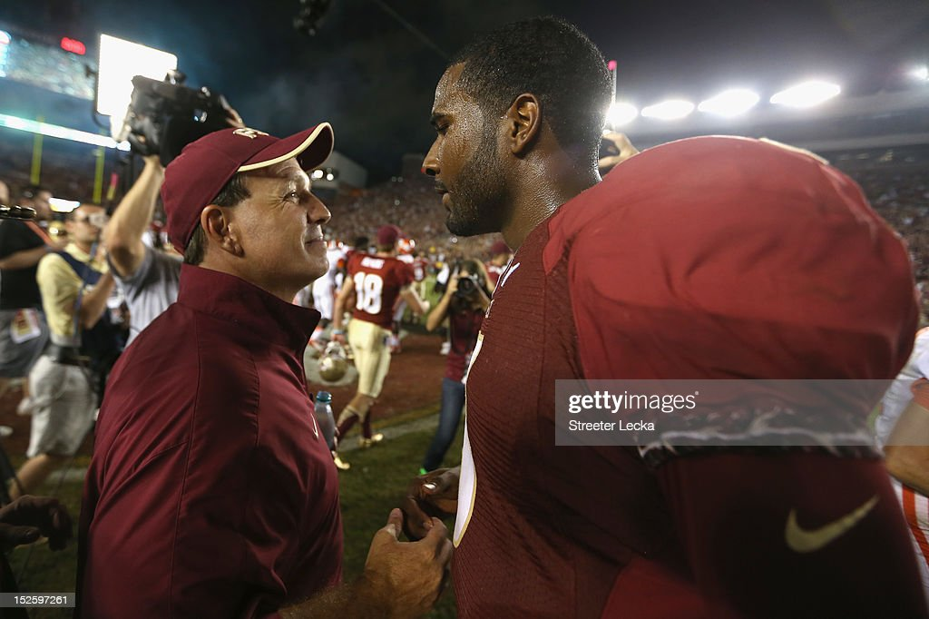 Head coach Jimbo Fisher of the Florida State Seminoles celebrates with his quarterback EJ Manuel #3 after defeating the Clemson Tigers 49-37 at Doak Campbell Stadium on September 22, 2012 in Tallahassee, Florida.
