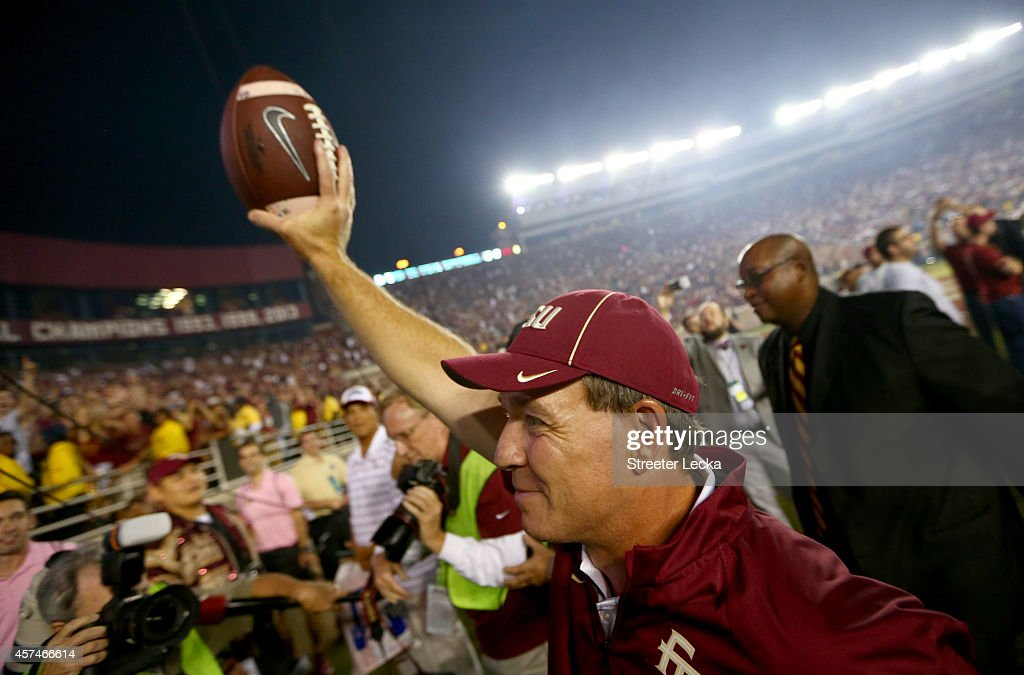 Head coach Jimbo Fisher of the Florida State Seminoles celebrates after defeating the Notre Dame Fighting Irish 31-27 at Doak Campbell Stadium on October 18, 2014 in Tallahassee, Florida.