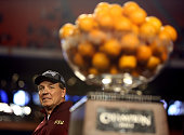 Head coach Jimbo Fisher of the Florida State Seminoles celebrates next to the trophy after they won 3110 against the Northern Illinois Huskies during...