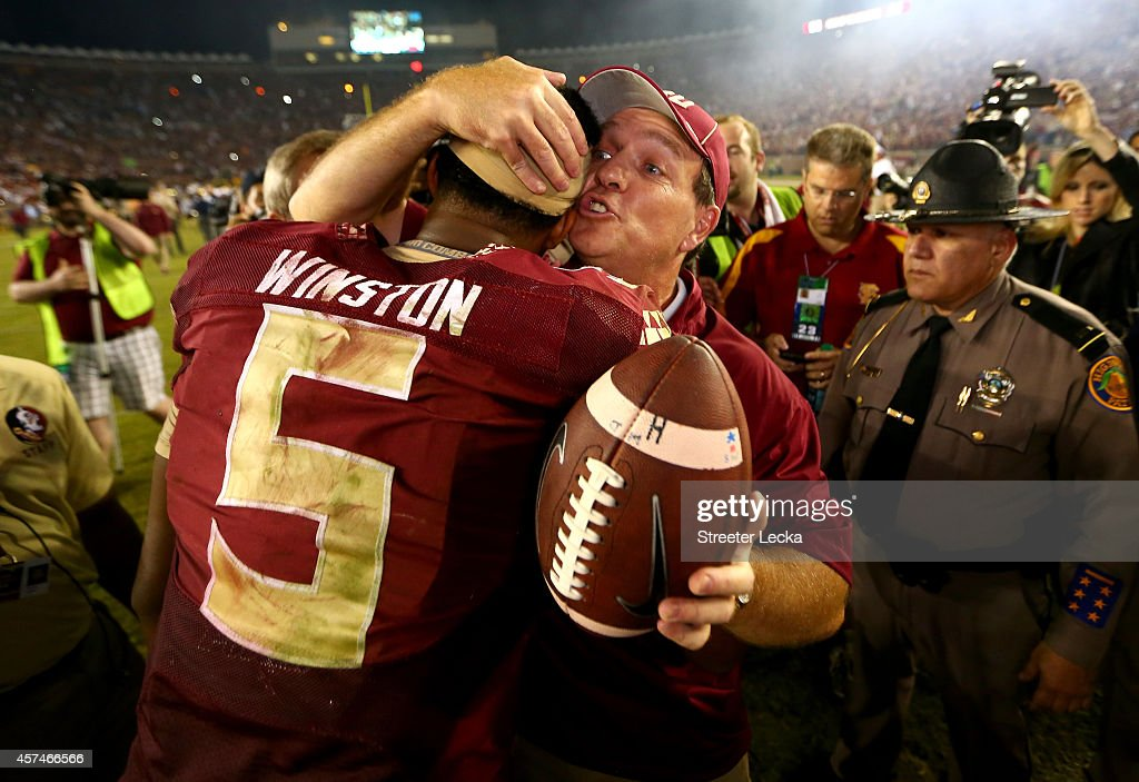 Head coach Jimbo Fisher of the Florida State Seminoles hugs Jameis Winston #5 after defeating the Notre Dame Fighting Irish 31-27 in their game at Doak Campbell Stadium on October 18, 2014 in Tallahassee, Florida.