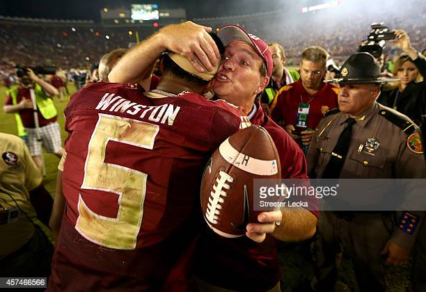 Head coach Jimbo Fisher of the Florida State Seminoles hugs Jameis Winston after defeating the Notre Dame Fighting Irish 3127 in their game at Doak...
