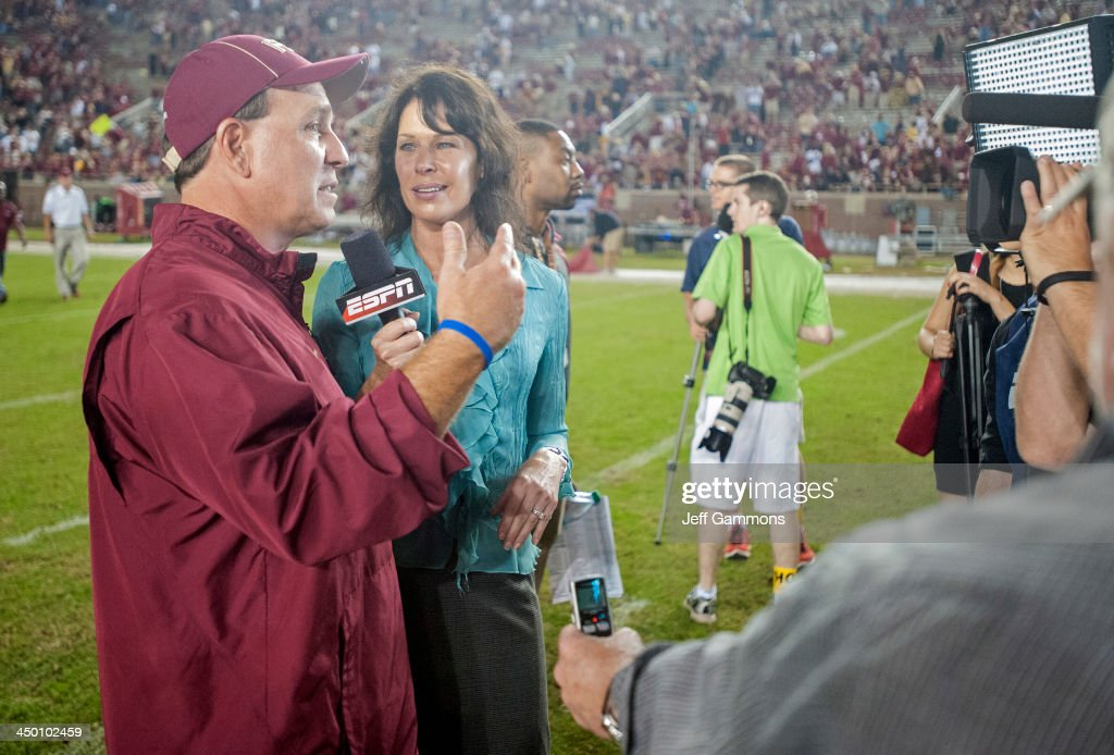 Head coach Jimbo Fisher of the Florida State Seminoles talks to a reporter post game at Doak Campbell Stadium on November 16, 2013 in Tallahassee, Florida. The Seminoles beat the Orange 59-3.