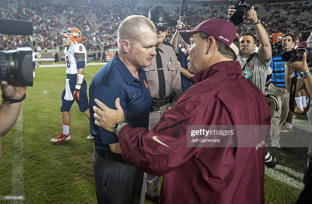 Head coach Jimbo Fisher of the Florida State Seminoles talks to Head Coach Scott Shafer of the Syracuse Orange post game at Doak Campbell Stadium on November 16, 2013 in Tallahassee, Florida. The Seminoles beat the Orange 59-3.