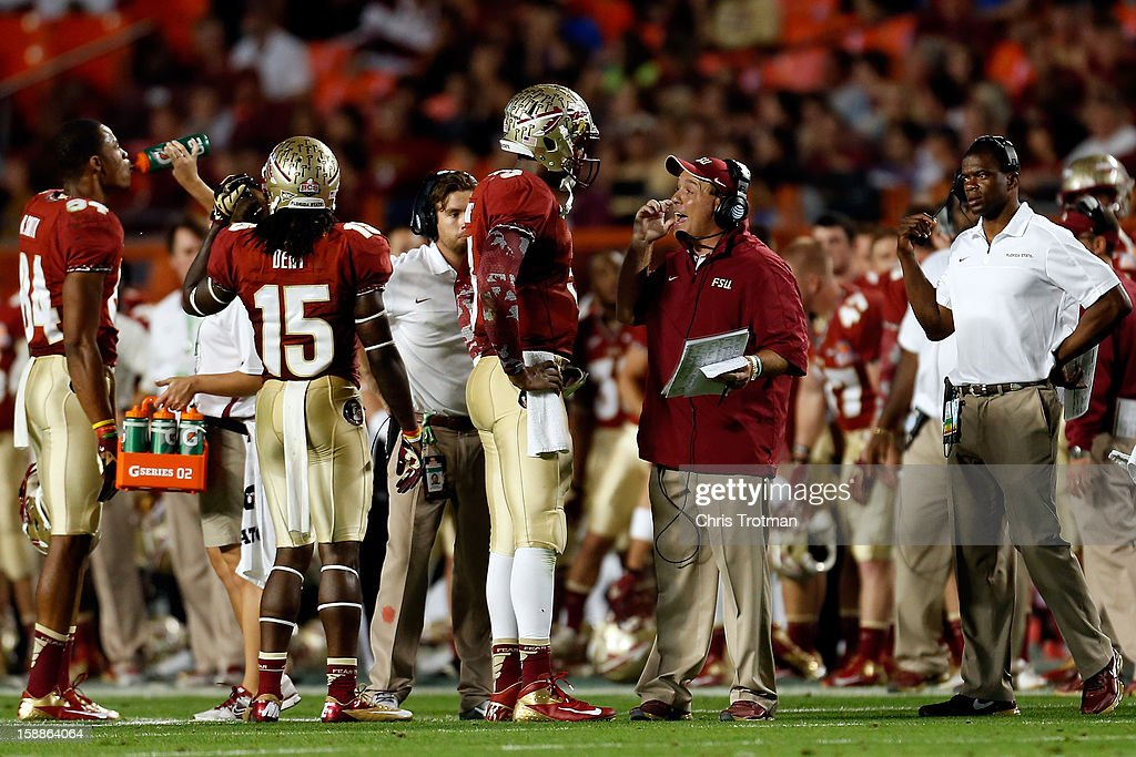 Head coach Jimbo Fisher of the Florida State Seminoles talks with quarterback EJ Manuel #3 against the Northern Illinois Huskies during the Discover Orange Bowl at Sun Life Stadium on January 1, 2013 in Miami Gardens, Florida.