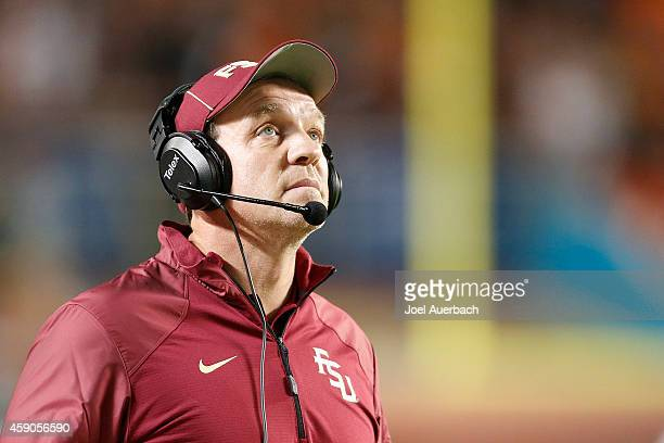 Head coach Jimbo Fisher of the Florida State Seminoles watches a replay during a break in second quarter action against the Miami Hurricanes on...