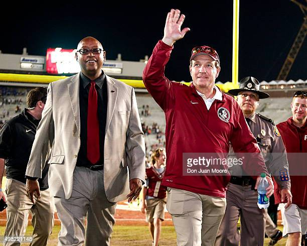 Head Coach Jimbo Fisher of the Florida State Seminoles wave to the fans after the game against the Chattanooga Mocs at Doak Campbell Stadium on Bobby...