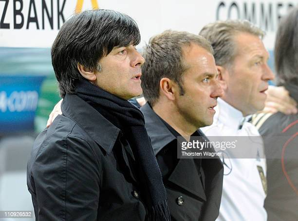 Head coach Joachim Loew 2nd coach HansDieter Flick and goalkeeper coach Andreas Koepke looks on prior to the EURO 2012 Group A qualifier match...