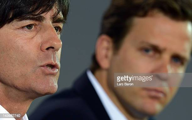 Head coach Joachim Loew adresses the media next to team manager Oliver Bierhoff during the DFB Euro 2012 squad announcement at MerzedesBenz center on...