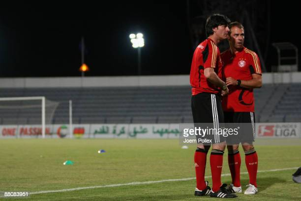 Head coach Joachim Loew and assistent coach Hansi Flick chat together during a Germany training session at the AlMaktoum Stadium on May 31 2009 in...