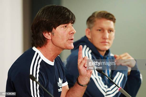 Head coach Joachim Loew and Bastian Schweinsteiger attend a Germany press conference at Commerzbank Arena on March 24 2015 in Kaiserslautern Germany