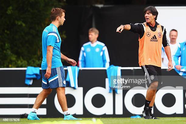 Head coach Joachim Loew and Mario Goetze attend a Germany training session at 'Kleine Kampfbahn' training ground on September 1 2015 in Frankfurt am...
