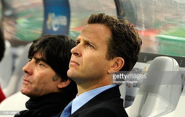 Head coach Joachim Loew and team manager Oliver Bierhoff looks on prior to the Euro 2012 Qualifier Group A match between Germany and Belgium at...
