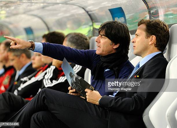 Head coach Joachim Loew and teammanager Oliver Bierhoff of Germany looks on prior to the Euro 2012 Qualifier Group A match between Germany and...