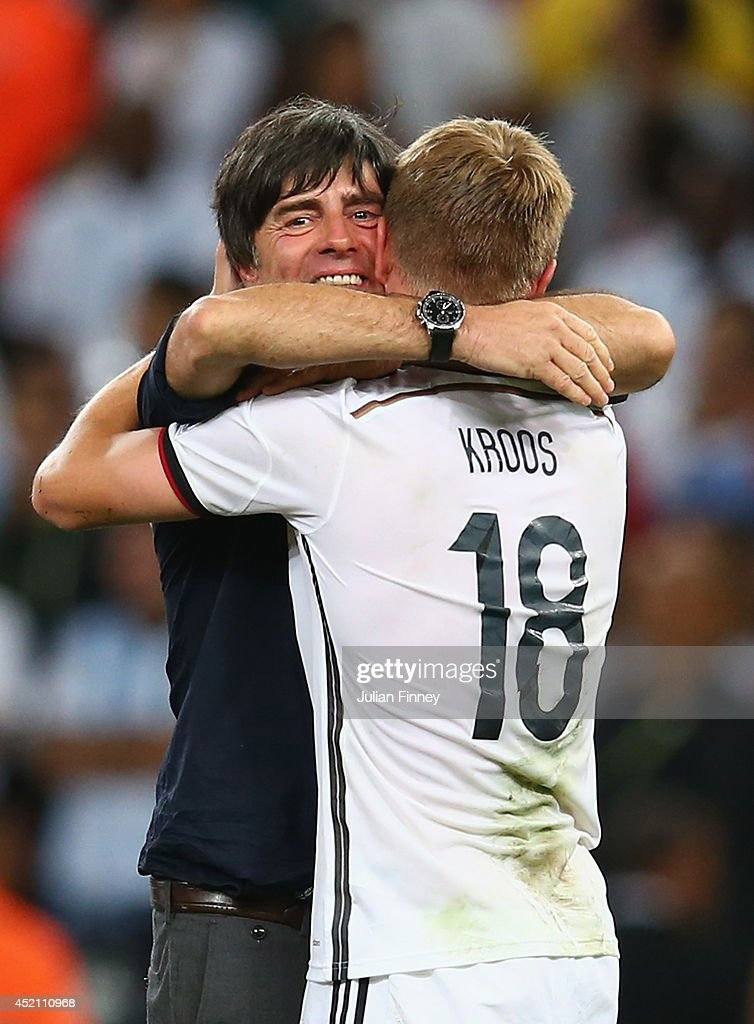 Head coach <a gi-track='captionPersonalityLinkClicked' href=/galleries/search?phrase=Joachim+Loew&family=editorial&specificpeople=215315 ng-click='$event.stopPropagation()'>Joachim Loew</a> and <a gi-track='captionPersonalityLinkClicked' href=/galleries/search?phrase=Toni+Kroos&family=editorial&specificpeople=638597 ng-click='$event.stopPropagation()'>Toni Kroos</a> of Germany celebrate defeating Argentina 1-0 in the 2014 FIFA World Cup Brazil Final match between Germany and Argentina at Maracana on July 13, 2014 in Rio de Janeiro, Brazil.