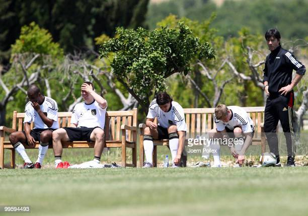 Head coach Joachim Loew Cacau Lukas Podolski Sami Khedira and Toni Kroos of Germany are pictured after the German National Team training session at...