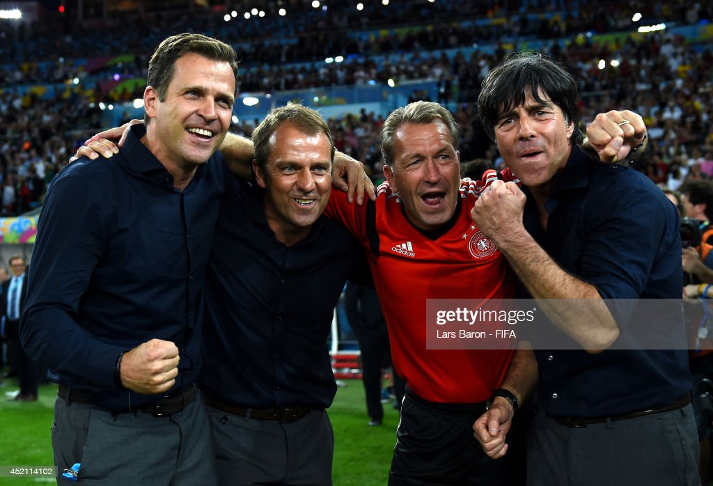Head coach <a gi-track='captionPersonalityLinkClicked' href=/galleries/search?phrase=Joachim+Loew&family=editorial&specificpeople=215315 ng-click='$event.stopPropagation()'>Joachim Loew</a> (1st R) celebrate winning the World Cup with team manager <a gi-track='captionPersonalityLinkClicked' href=/galleries/search?phrase=Oliver+Bierhoff&family=editorial&specificpeople=213661 ng-click='$event.stopPropagation()'>Oliver Bierhoff</a> (1st L), assistant coach Hansi Flick (2nd L) and goal keeper coach Andreas Koepke (2nd R) after the 2014 FIFA World Cup Brazil Final match between Germany and Argentina at Maracana on July 13, 2014 in Rio de Janeiro, Brazil.