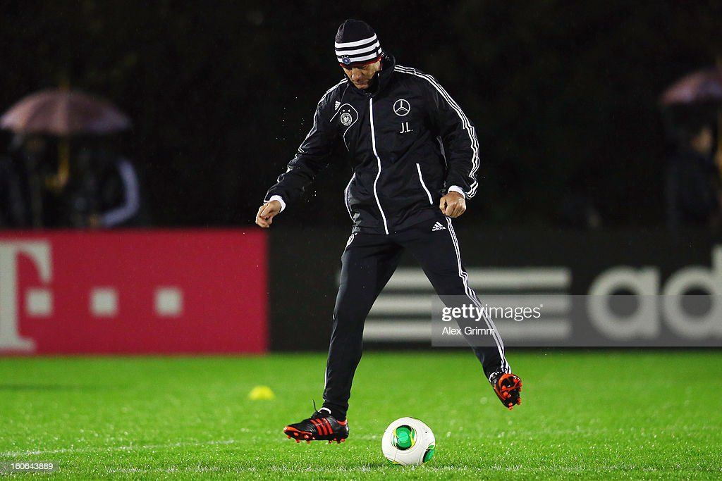 Head coach <a gi-track='captionPersonalityLinkClicked' href=/galleries/search?phrase=Joachim+Loew&family=editorial&specificpeople=215315 ng-click='$event.stopPropagation()'>Joachim Loew</a> exercises during a Germany training session at Commerzbank-Arena on February 4, 2013 in Frankfurt am Main, Germany.