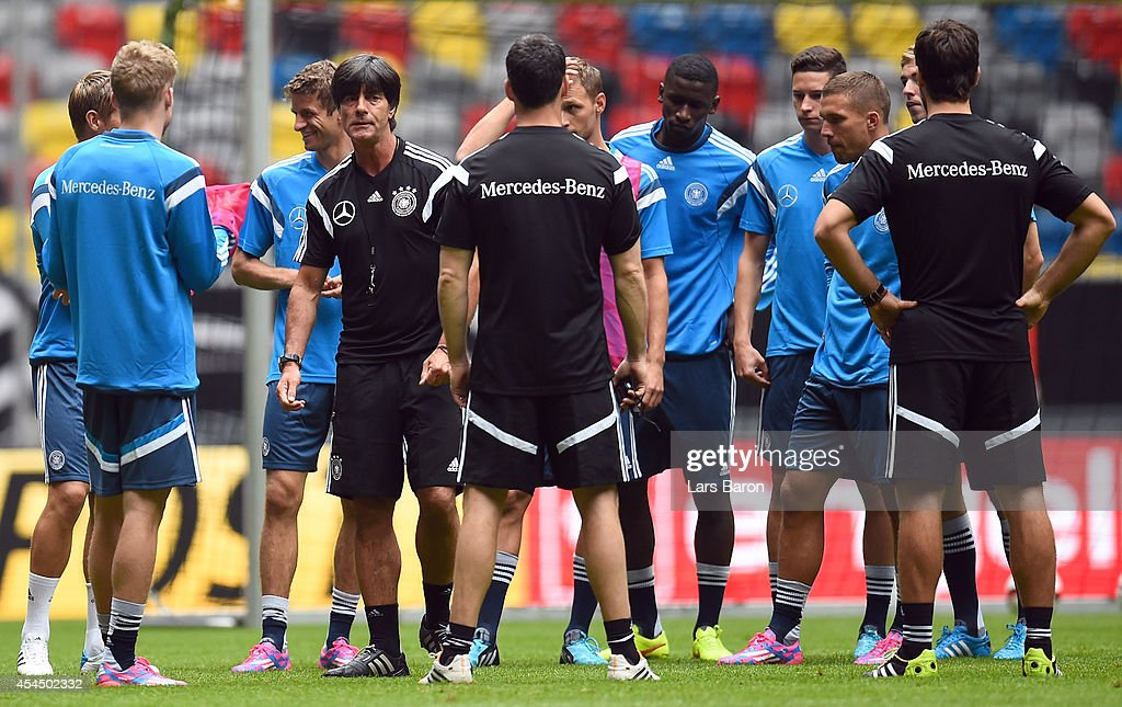 Head coach <a gi-track='captionPersonalityLinkClicked' href=/galleries/search?phrase=Joachim+Loew&family=editorial&specificpeople=215315 ng-click='$event.stopPropagation()'>Joachim Loew</a> gives instructions to his players during a Germany training session at Esprit Arena on September 2, 2014 in Duesseldorf, Germany.