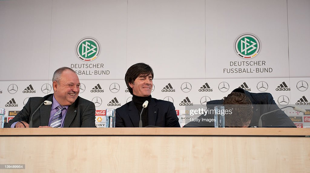 Head coach <a gi-track='captionPersonalityLinkClicked' href=/galleries/search?phrase=Joachim+Loew&family=editorial&specificpeople=215315 ng-click='$event.stopPropagation()'>Joachim Loew</a> (C), media director <a gi-track='captionPersonalityLinkClicked' href=/galleries/search?phrase=Harald+Stenger&family=editorial&specificpeople=558376 ng-click='$event.stopPropagation()'>Harald Stenger</a> (L) and team manager <a gi-track='captionPersonalityLinkClicked' href=/galleries/search?phrase=Oliver+Bierhoff&family=editorial&specificpeople=213661 ng-click='$event.stopPropagation()'>Oliver Bierhoff</a> (R) attend a DFB EURO 2012 press conference at Mercedes Benz World on February 22, 2012 in Berlin, Germany.