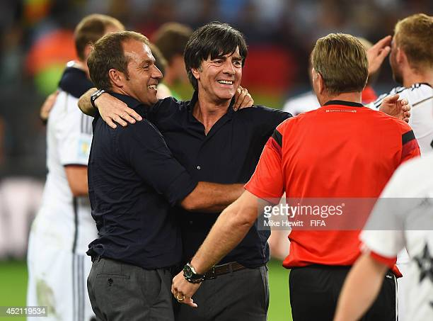 Head coach Joachim Loew of Germany and assistant coach Hansi Flick celebrate after the 2014 FIFA World Cup Brazil Final match between Germany and...